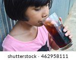 little girl drinking soda water ... | Shutterstock . vector #462958111