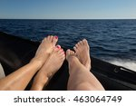 Two Female's Feet Relaxing On ...