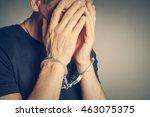 male hands in handcuffs | Shutterstock . vector #463075375