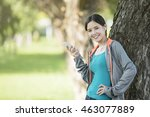 young asian woman happily using ... | Shutterstock . vector #463077889