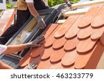 hands of roofer laying tile on...   Shutterstock . vector #463233779