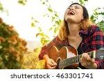 Countyr Girl Playing Guitar An...