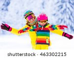 mother and little child skiing... | Shutterstock . vector #463302215