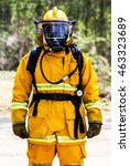 Small photo of Yellow fire suit S.C.B.A , and oxygen tank with respirator with air pressure gauge