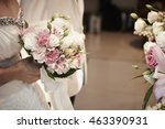 bride holding flower bouquet   Shutterstock . vector #463390931