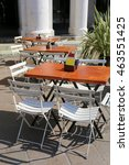 Small photo of alfresco tables and chairs of the city