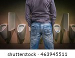 Standing Man Peeing To A Urina...