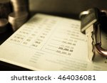 rows of coins on account book... | Shutterstock . vector #464036081