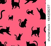 Stock vector seamless pattern with black cats silhouettes on pink background 464208257