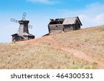 Old Windmill And A Wooden Barn...