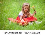 beautiful little girl picking... | Shutterstock . vector #464438105