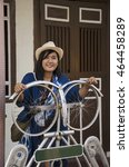 Small photo of Thai woman travel and portrait on Aceh Street at George Town and street art area in Penang, Malaysia.