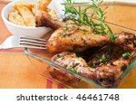 roast chicken leg with herbs and potato - stock photo