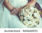 bride in white dress holding... | Shutterstock . vector #464660051
