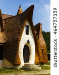 Small photo of Clay Castle, Fairy Valley, Romania - 27 july 2016 - The pension made of clay and other natural materials is almost 90% ready