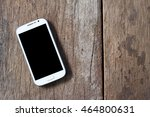 smartphone on old wooden table... | Shutterstock . vector #464800631