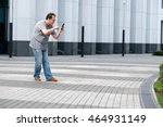 man playing mobile game at the... | Shutterstock . vector #464931149