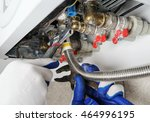 plumber attaches to pipe gas... | Shutterstock . vector #464996195