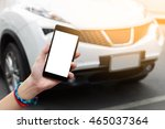 Stock photo woman hand holding smartphone isolated white screen on road with white car background 465037364
