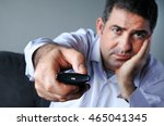 upset and bored man holding tv... | Shutterstock . vector #465041345