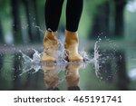 feet in rubber boots rain... | Shutterstock . vector #465191741
