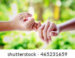two hands hook each other's... | Shutterstock . vector #465231659