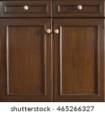 Stock photo front kitchen wooden frame cabinet door and drawers made from dark wood background and texture 465266327