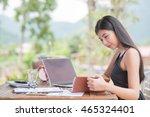 young woman wearing smartwatch... | Shutterstock . vector #465324401
