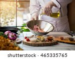 liquid pours on raw meat. hands ...   Shutterstock . vector #465335765