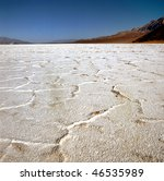Badwater Basin (a dried salt lake) in Death valley, California. Death Valley is the hottest and driest place in North America - stock photo
