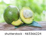 avocado  on a wooden floor and... | Shutterstock . vector #465366224