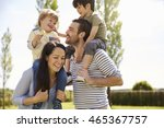 parents giving sons ride on... | Shutterstock . vector #465367757