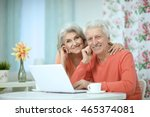 happy senior couple with laptop | Shutterstock . vector #465374081