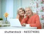 happy senior couple with laptop   Shutterstock . vector #465374081