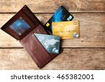 Stock photo credit cards in leather wallet on wooden background 465382001