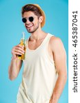 cheerful young man in hat and... | Shutterstock . vector #465387041