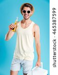 happy handsome young man with... | Shutterstock . vector #465387599