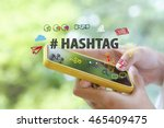 hand holding a smartphone with... | Shutterstock . vector #465409475