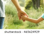 hands of parent and child in... | Shutterstock . vector #465624929