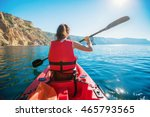 kayaking. a woman in a kayak.... | Shutterstock . vector #465793565