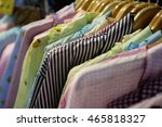 hanging clothes in a row  | Shutterstock . vector #465818327