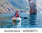 Young Fisherman in a Kayak. Fishing Boat in the sea.  - stock photo