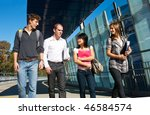 Stock photo four university students walking to class over a modern bridge on a beautiful sunny day 46584574