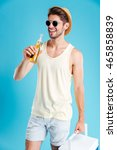 cheerful young man in hat and... | Shutterstock . vector #465858839