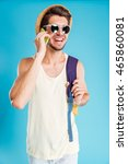 smiling young man in hat and... | Shutterstock . vector #465860081