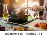 tongs hold fried meat. pieces... | Shutterstock . vector #465882491