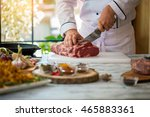 hand with knife cuts meat....   Shutterstock . vector #465883361