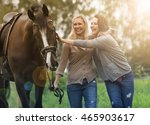 Two Woman Walking With Horse A...