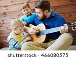 playing guitar with father | Shutterstock . vector #466080575