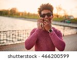 Black Young Man On The Phone...